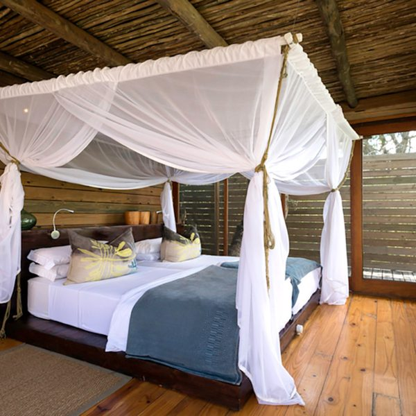 The beds at Vumbura Plains are protected by mosquito nets. © Wilderness Safaris