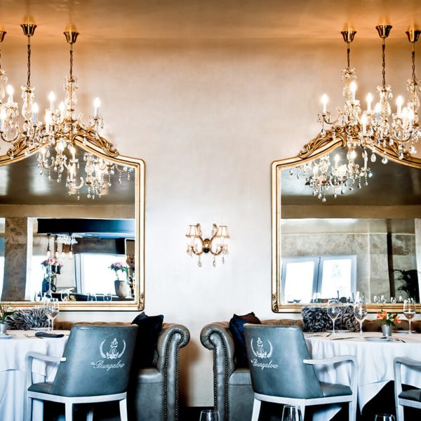 Dine under lovely chandeliers at The Bungalow. © The Bungalow