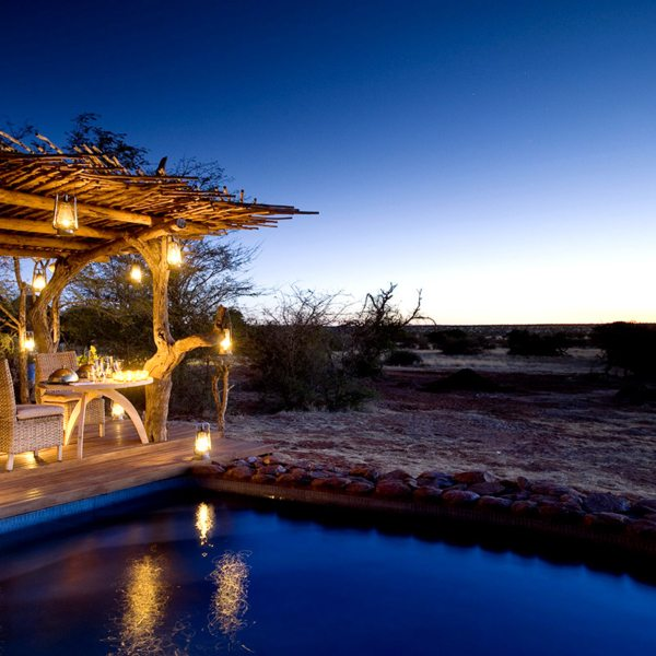 You can dine privately, next to the pool, at The Motse. © Tswalu Kalahari