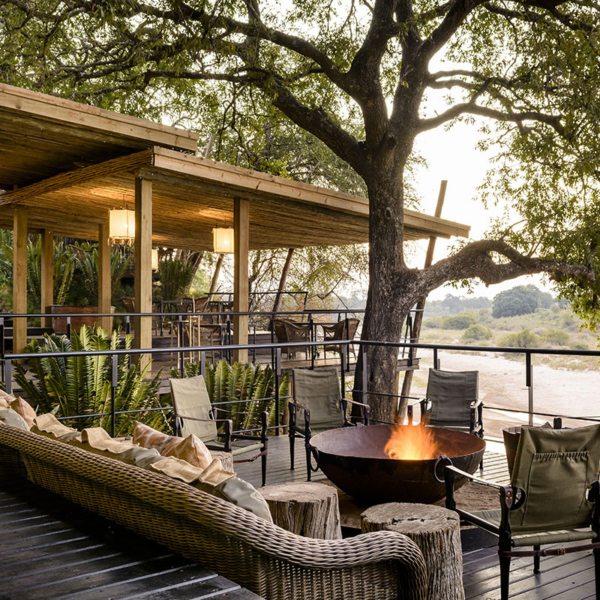 Ebony Lodge's guest-area deck overlooks the Sand River. © Singita