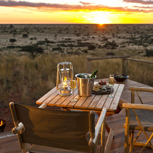 Sip on bubbly while watching the sunset on your private deck at The Malori. © Tswalu Kalahari