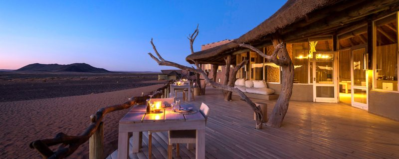 Sit on Little Kulala's guest-area deck and watch as night falls.