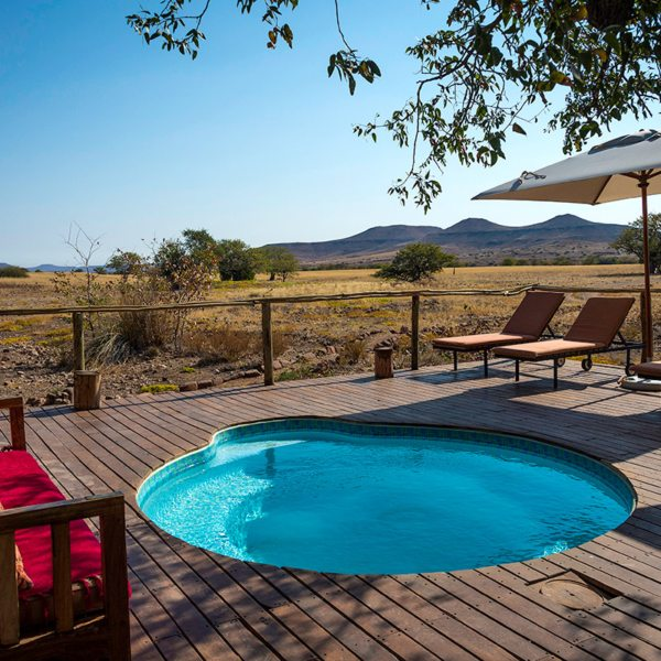 Cool off in the pool at Desert Rhino Camp. © Wilderness Safaris