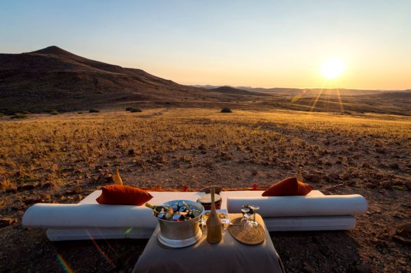Sundowners are a must at Desert Rhino Camp. © Wilderness Safaris