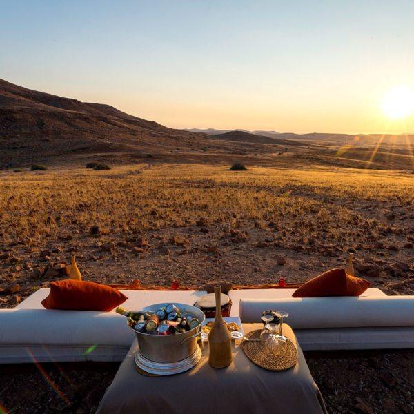 Sundowners are a must at Desert Rhino Camp. © Wilderness Safaris