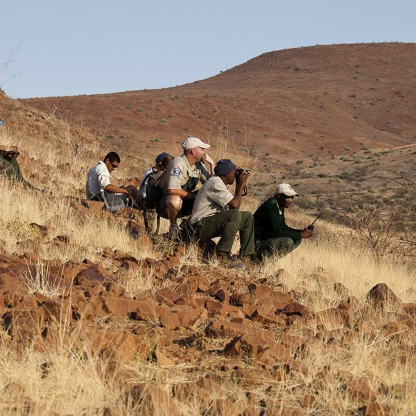 Your guide will ensure your safety when tracking desert rhino on foot. © Wilderness Safaris