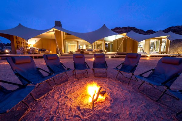 End your day at Hoanib Skeleton Coast with fireside conversation. © Wilderness Safaris