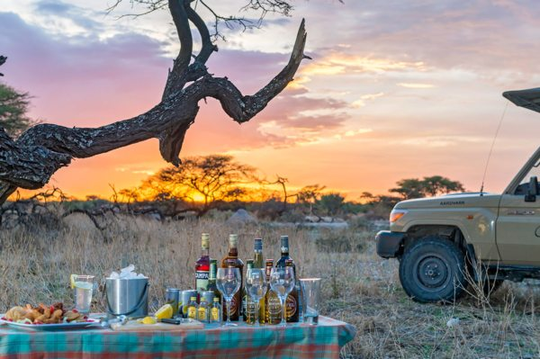Enjoy sundowners in the bush near Onguma The Fort. © Onguma