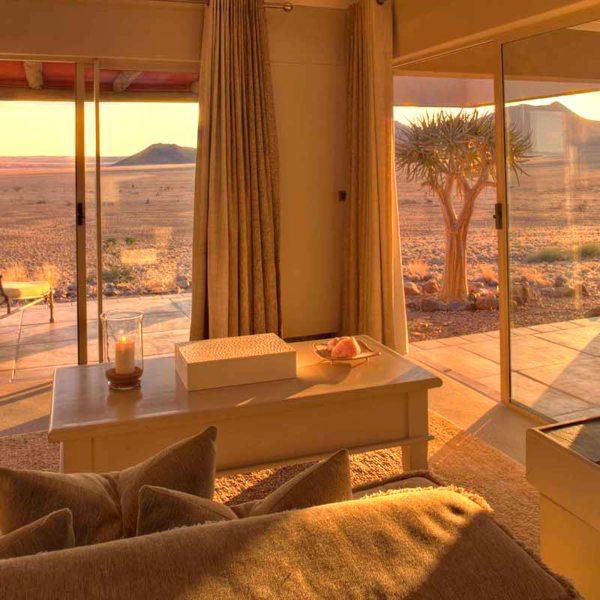Roaring fires will keep your desert suite at Sossusvlei Desert Lodge warm on cooler evenings. © &Beyond