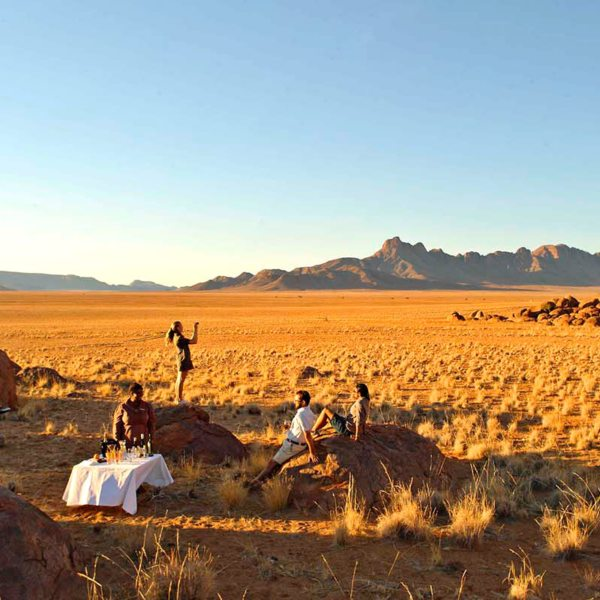 Have breakfast cooked for you out in the wilderness at Sossusvlei Desert Lodge. © &Beyond