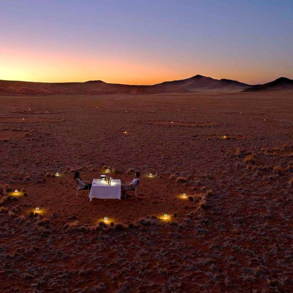 Enjoy the unique experience of having dinner inside a mysterious fairy circle when staying at Sossusvlei Desert Lodge. © &Beyond