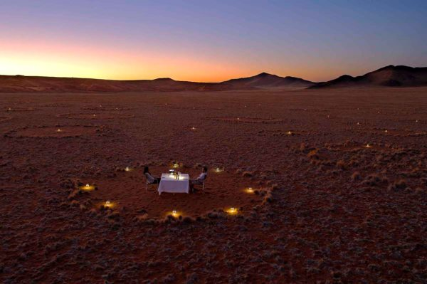 Enjoy the unique experience of having dinner inside a mysterious fairy circle when staying at Sossusvlei Desert Lodge. © Sossusvlei Desert Lodge