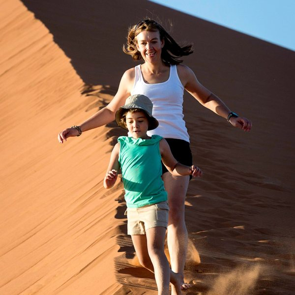 Running down dunes is as fun for adults as it is for kids. © Wilderness Safaris