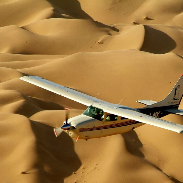 Take a scenic flight over the dunes. © Wolwedans
