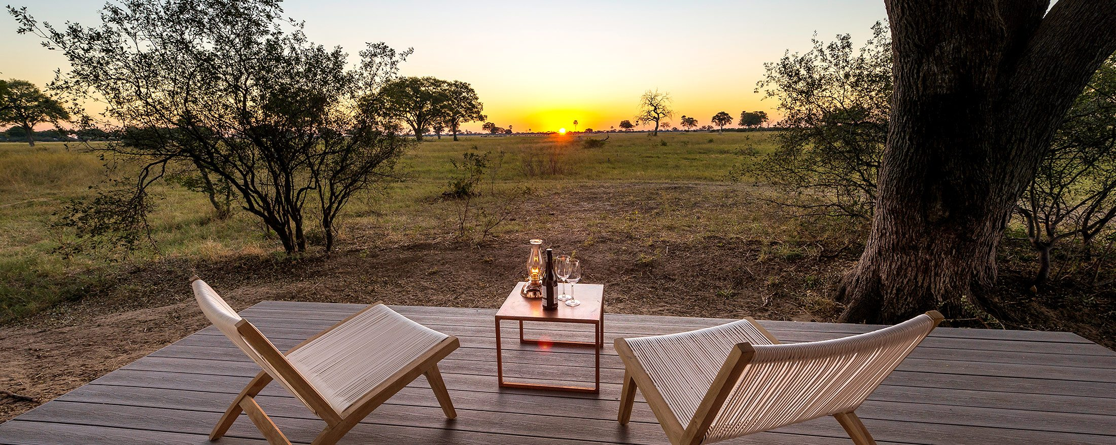 Enjoy the African sunset in all its glory from your tented suite's deck at Linkwasha Camp.