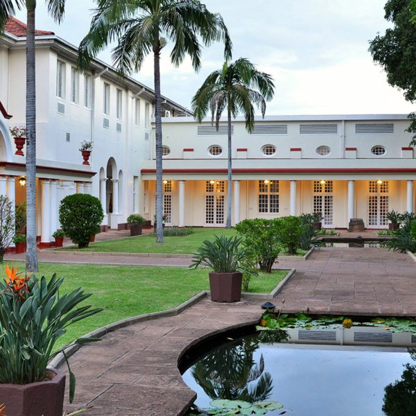 Victoria Falls Hotel faces onto manicured gardens.