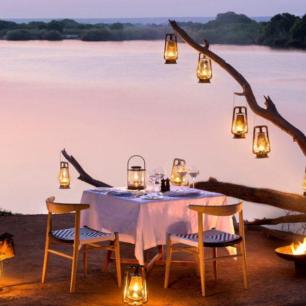 Enjoy private riverside dining at Matetsi River Lodge.