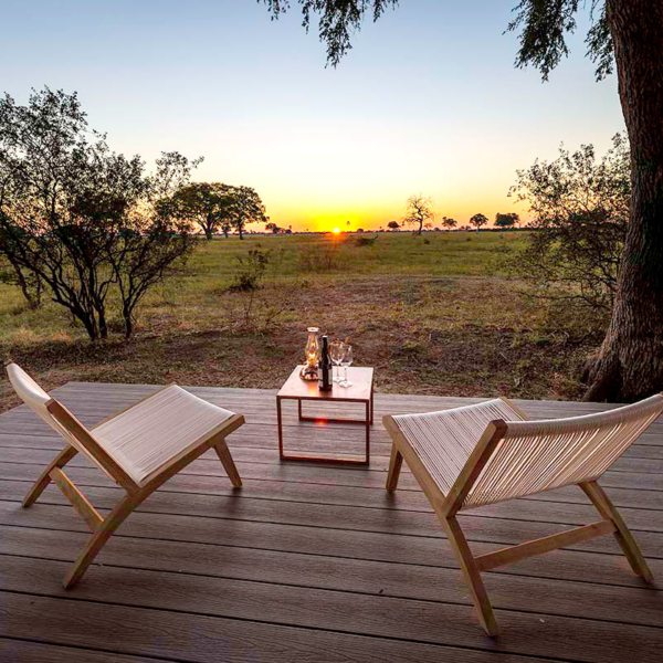 Enjoy the African sunset in all its glory from your tented suite's deck at Linkwasha Camp. © Wilderness Safaris