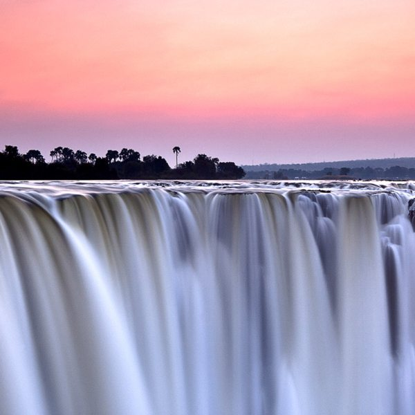Rise early to see the magnificent Victoria Falls at dawn during your luxury Victoria Falls safari.