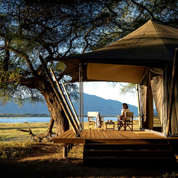 The tented suites at Ruckomechi Camp have lovely river views. © Wilderness Safaris