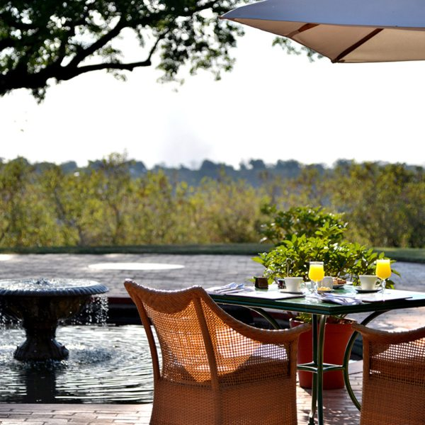 Start your day with an alfresco breakfast at Victoria Falls Hotel. © Victoria Falls Hotel