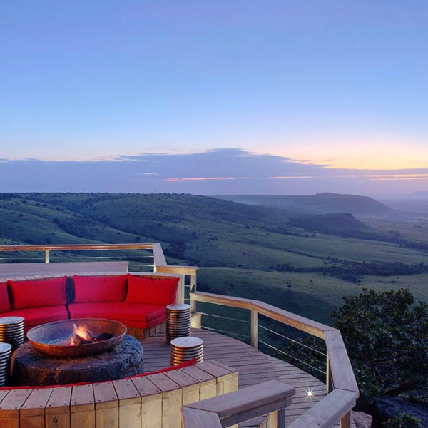 The fire pit at Angama Mara, perched high above the Great Rift Valley, is perfectly positioned for sundowner drinks. © Angama Mara