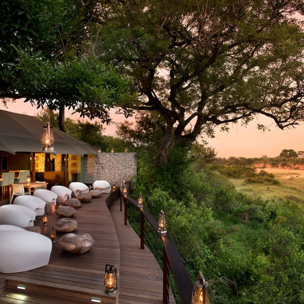 Comfortable egg chairs invite lazy afternoons watching wildlife right from the guest deck at Ngala Tented Camp. © &Beyond