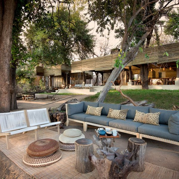 Spend some time relaxing in the outdoor guest area at Matetsi River Lodge. © &Beyond