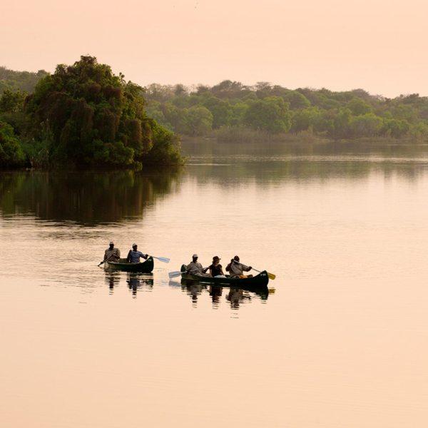 Explore the Zambezi with a canoe safari from Matetsi River Lodge. © &Beyond