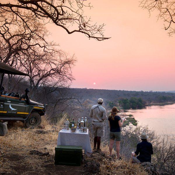 Sundowner drinks overlooking the Zambezi are a wonderful way to end the day at Matetsi River Lodge. © &Beyond