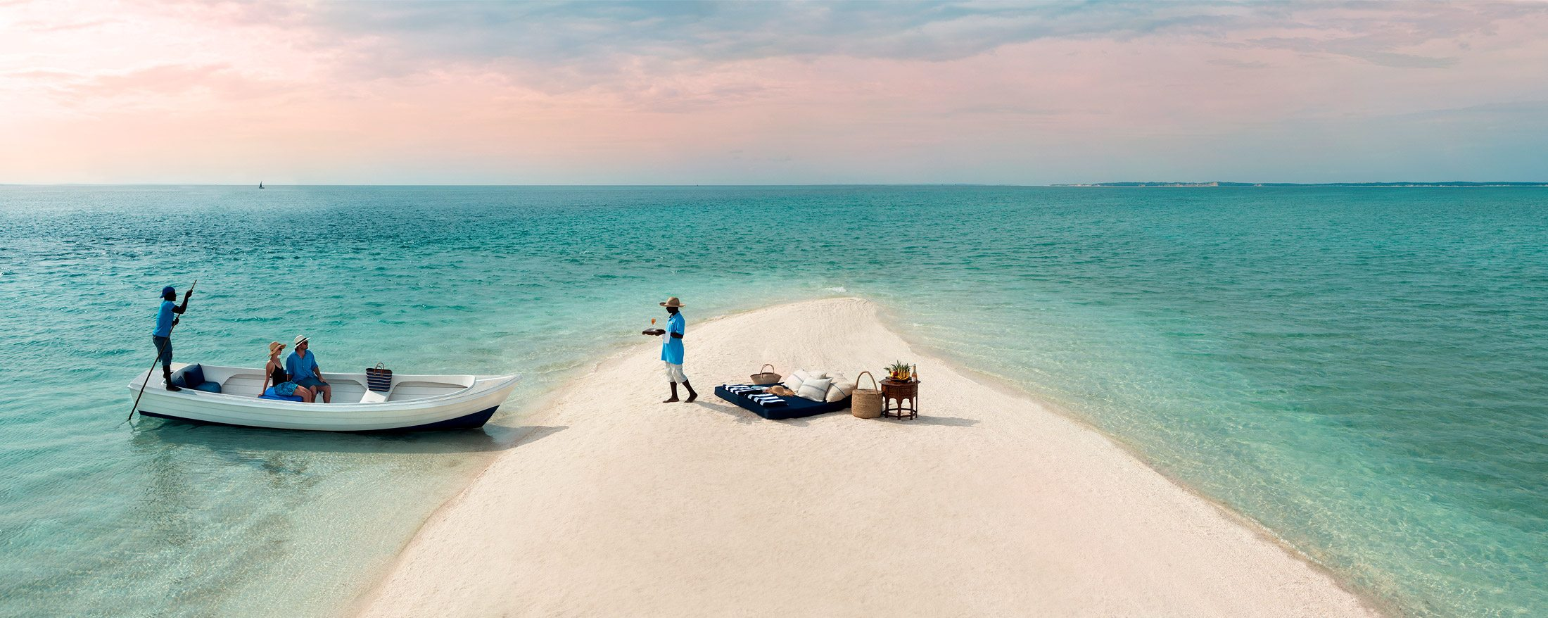 You'll arrive by boat for your private sandbar picnic in Mozambique.