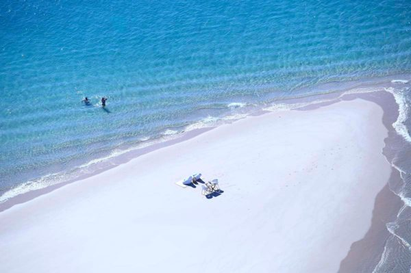 Cool off with a swim during your Mozambican sandbar picnic. © Azura Boutique Retreats