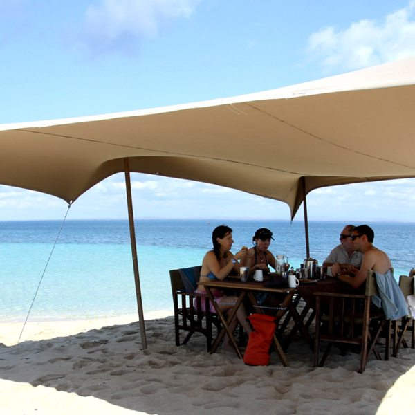 Stop for brunch on a sandbar when island hopping in the Quirimbas. © Ibo Island Lodge