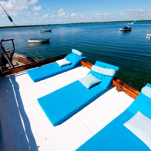 Your dhow sundeck will have loungers to relax on when you go island hopping in the Quirimbas. © Ibo Island Lodge