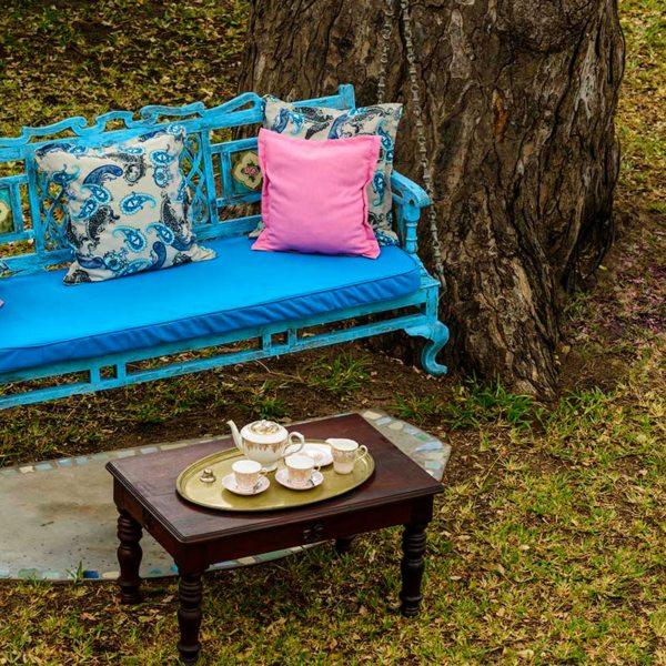 Take your tea on a swing bench at Ibo Island Lodge. © Ibo Island Lodge