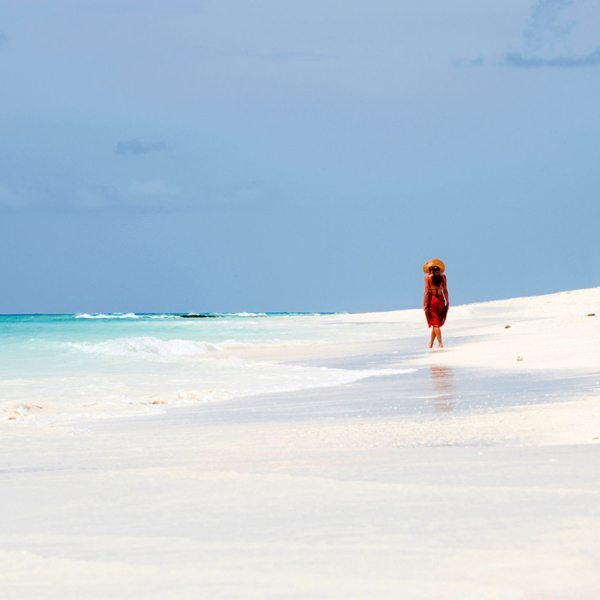 A sandbar picnic in Mozambique will give you time to reflect. © &Beyond