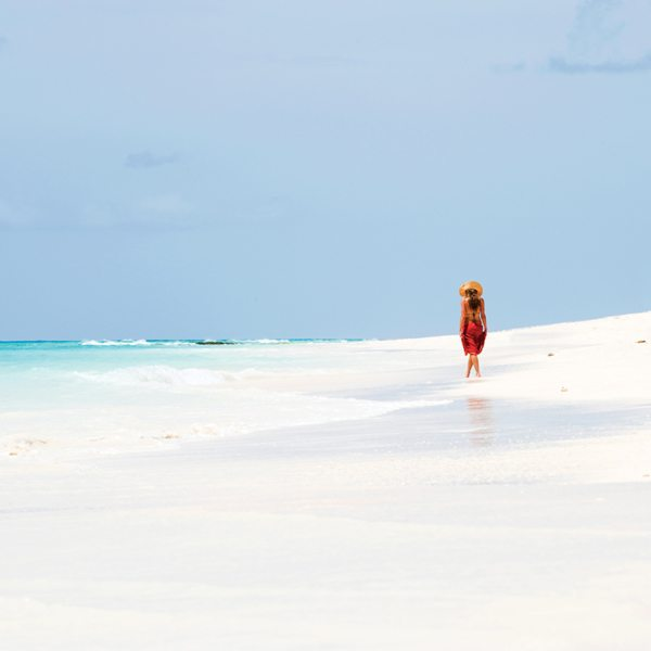 Get some me-time with a quiet beach walk at Vamizi Island. © &Beyond