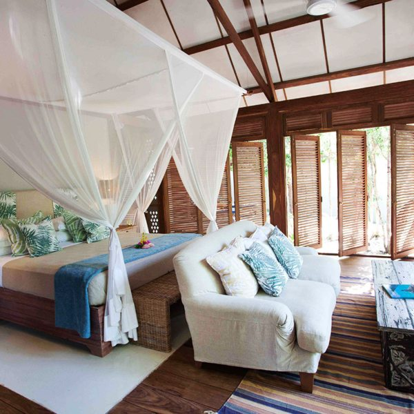 Vamizi Island's Kipila villa accommodates eight adults plus four kids in five rooms. © &Beyond