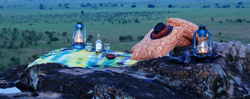 Sip sundowners on a rocky ridge near Apoka Safari Lodge.