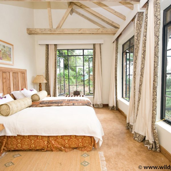 The plentiful windows in the cottages at Clouds Mountain Gorilla Lodge allow you to appreciate the wilderness even when indoors. © Uganda Safari Company