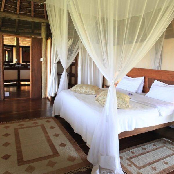 You'll sleep well in the solid beds at Apoka Safari Lodge. © Uganda Safari Company