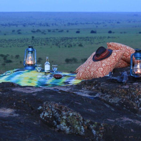 Sip sundowners on a rocky ridge near Apoka Safari Lodge. © Uganda Safari Company