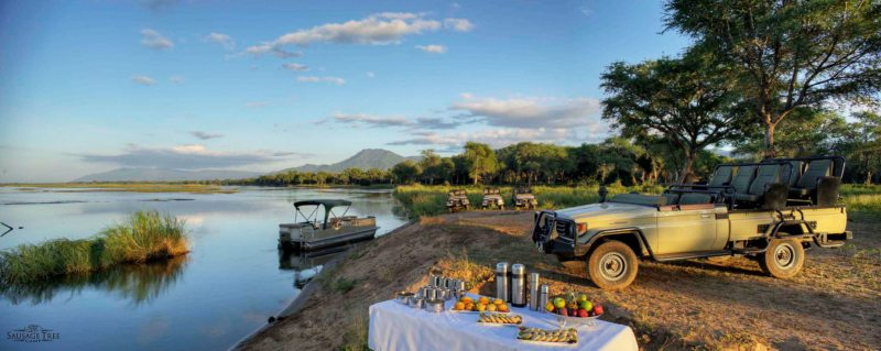 Stop for refreshments during your game drive from Sausage Tree Camp.
