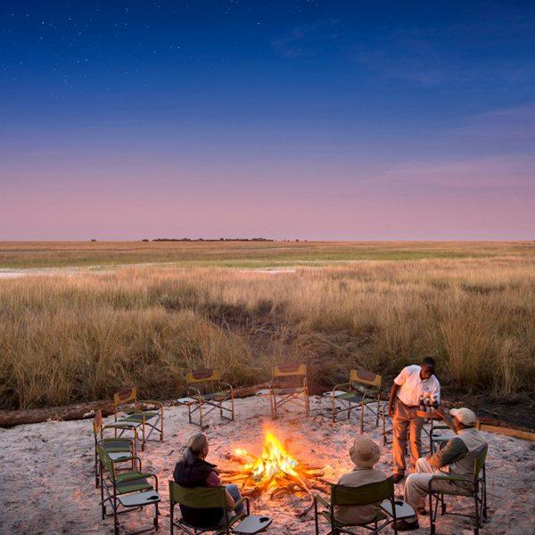 Enjoy an authentic bush campfire at King Lewanika Lodge. © Time + Tide