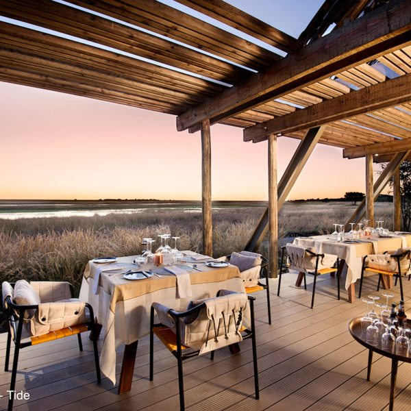 Gaze across the plains while you dine at King Lewanika Lodge. © Time + Tide