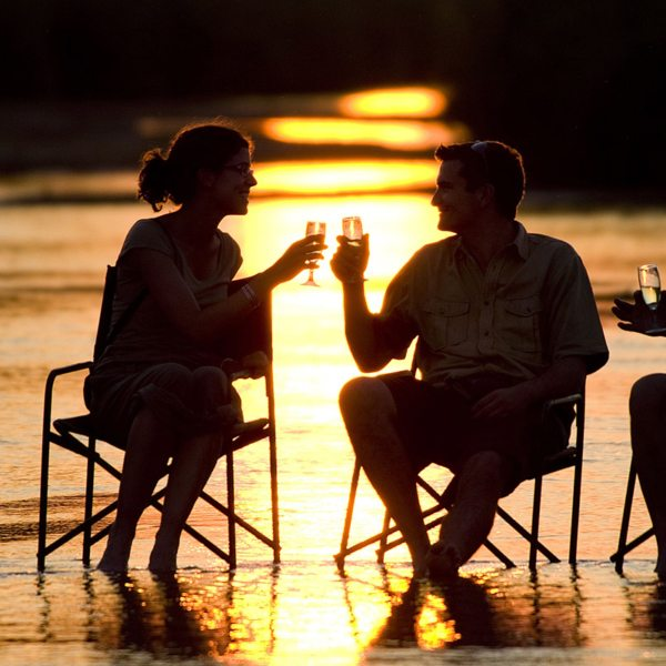 You'll toast to a good day every day of your Zambia walking safari. © Robin Pope Safaris