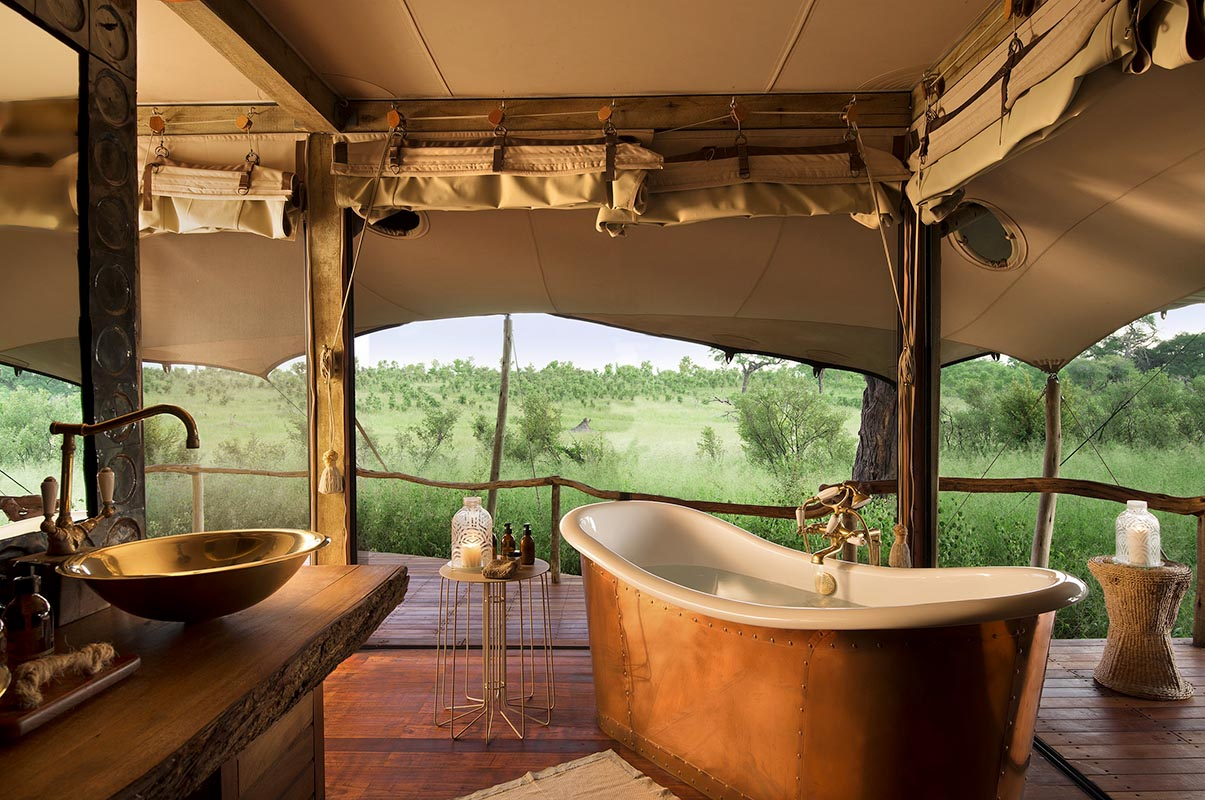 Relax in the tub while enjoying the view from your family tent at Somalisa Acacia. © African Bush C&s & Luxury Zimbabwe Family Safari Lodge | Somalisa Acacia | Art Of Safari