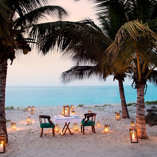 Enjoy a romantic, private beach dinner at Benguerra Island Lodge.