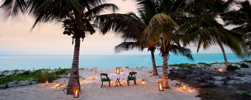 Enjoy a romantic, private beach dinner at Benguerra Island Lodge.