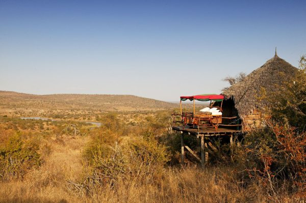 The beds at Loisaba Star Beds roll out onto the decks, so you sleep outdoors. © Elewana Collection